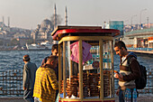 People buying sesame pastries at a kiosk on the waterfront, Istanbul, Turkey, Europe