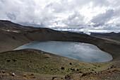 Crater lake under clouded sky, Viti Explosion Crater in Krafla Geothermal Area, Krafla, Nordurland Eystra, Iceland, Europe