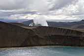 Hikers on Rim of Viti Explosion Crater in Krafla Geothermal Area, Krafla, Nordurland Eystra, Iceland, Europe