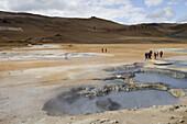 Visitors in Krafla Geothermal Area, Krafla, Nordurland Eystra, Iceland, Europe