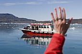 Waving hand and excursion boat at Qooroq Fjord, Narsarsuaq, Kitaa, Greenland