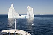 Cruise ship MS Deutschland approaching iceberg from Ilulissat Kangerlua Icefjord, Ilulissat (Jakobshavn), Disko Bay, Kitaa, Greenland