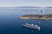 Aerial view of cruise ship MS Deutschland and icebergs, Ilulissat (Jakobshavn), Disko Bay, Kitaa, Greenland