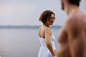 Mid adult woman flirting with a man, Starnberger See, Upper Bavaria, Germany