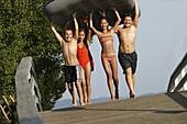 Four children carrying an air mattress, Ueberlingen, Lake Constance, Baden-Wuerttemberg, Germany