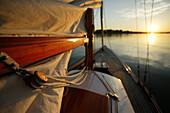 Classic wooden sailing yacht from 1929 near Krautinsel, Lake Chiemsee, Chiemgau, Bavaria, Germany