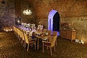 Festively set table in cellar vault, Bavaria, Germany