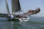 Libera sailing yacht, 8 sailors in the trapeze, Chiemsee, Bavaria, Germany