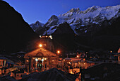 Holy Hindu temple dedicated to Shiva in Kedernath with Kedernath mountains in the evening, Uttarakhand, India, Asia
