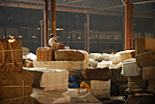 Man at a warehouse at Howrah Station in the evening, Howrah, India, Asia
