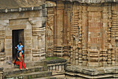 indian woman and girl in Lingaraja Temple, Bhubaneshwar, Orissa, India, Asia