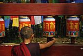 Novice with prayer wheel, Enchey monastery, Sikkim, Himalaya, Northern India, Asia