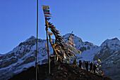 People and prayer flags at Dzongri La, Trek towards Gocha La in Kangchenjunga region, Sikkim, Himalaya, Northern India, Asia