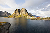 View at little fishing village in front of typical rock formation, Lofoten, Norway, Scandinavia, Europe