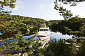 Yacht at the shore of a lake amidst idyllic scenery, Sorland, Norway, Scandinavia, Europe