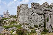 Ruins of the 7000 year old Ggantija temple, in the background the Xewkija church, Gozo, Malta, Europe