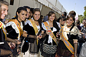 Young women in traditional costumes sampling wines, Sitges, Catalonia, Spain, Europe