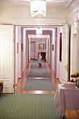 Child in bathrobe on a corridor, Hotel Waldhaus, Flims, Canton of Grisons, Switzerland