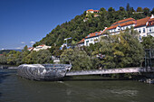 Murinsel is an artificial island on the Mur river, in the back is Schlossberg, Graz, Styria, Austria