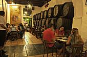 Guests in a bodega, El Pimpi, Malaga, Andalusia, Spain