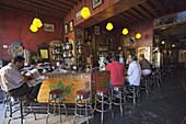 Guests inside a bar, Malaga, Andalusia, Spain