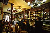 Guests in the old bar Casa Alberto, Calle de Huertas, Madrid, Spain