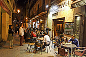 Guests in bars in the evening, Calle de Huertas, Madrid, Spain