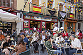 Guests in a pavement cafe, Madrid, Spain