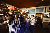 Guests inside a Tapa bar, Plaza de la Paja, Madrid, Spain