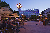 Pavement cafes Placa Sant Ana in the evening, Hotel Me Madrid Reina Victoria in background, Calle de Huertas, Madrid, Spain