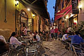 Guests in a pavement cafe near Piazza Olivella, Palermo, Sicily, Italy
