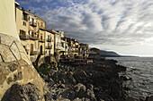 Open-air restaurant near coastline, Cefalu, Sicily, Italy