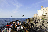 Open-air restaurant on a jetty, Cefalu, Sicily, Italy