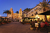 Open-air restaurant near Cathedral-Basilica of Cefalu, Sicily, Italy