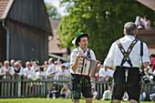 Accordionist wearing traditional costume, May Running, Antdorf, Upper Bavaria, Germany