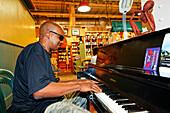 Piano player at Reading Terminal Market, Philadelphia, Pennsylvania, USA