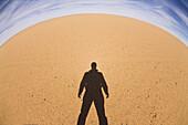 Shadow of a single man in the libyan desert, Libya, Sahara, North Africa