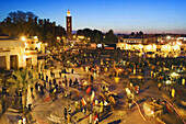 Jemaa el Fna square and Koutoubia mosque minaret in background, Marrakech, Morocco