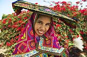 Girl wearing typical dress of the Cusco region, Peru