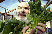 Alternative medicine advisor and practitioner of integrative medicine, Dr  Andrew Weil, grows organic spinach and other produce at his home in Vail, Arizona, USA