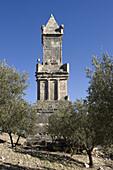 Mausoleum amid olive trees below Dougga City, Roman ruins of Dougga, Tunisia  December 2008)