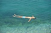 Bath in the sea. Simi, Dodecanese islands, Greece