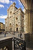 Façade of Santa Maria del Fiore cathedral from the Loggia del Bigallo, Florence. Tuscany, Italy
