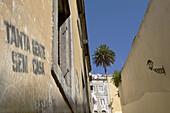Narrow lane in the Baixa quarter, Lisbon, Portugal
