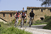 Mountain bikers on a track at Monte Colognola, Umbria, Italy, Europe