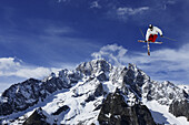 Freestyle skier in mid-air in front of Mont Blanc, Courmayeur, Italy, Europe