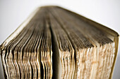 Aged, Book, Books, Close-up, Closeup, Color, Colour, Concept, Concepts, Idea, Ideas, Old, Open, Page, Pages, Paper, Selective focus, Still life, Studio shot, B75-765977, agefotostock