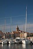 Italy, Sardinia, Western Sardinia, Alghero, city walls from the yacht marina, morning