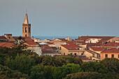 Italy, Sardinia, Western Sardinia, Alghero, aerial over the city from the west, sunrise