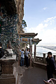 Chinese tourists in front of Dragon Gate, view over Dian Lake, Hill of the Sleeping Buddha, Taihua Temple, Kunming, Yunnan, People's Republic of China, Asia